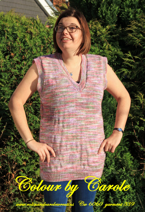 "A sleeveless top hand knitted aboard the narrow boat ""Emma Maye"" in Lancashire by Carole Wareing of Colin and Carole's Creations. Created from a shade sw 5 from J C Brett's ""Stonewash"" which is an acrylic yarn. Colours are pastel shades of grey, pink, lilac and greens. It is a size 16 garment, chest size 42inch, and 28inch long Machine washable at 30 degrees C Price is £50 including p and p to a UK address, please enquire for overseas delivery."