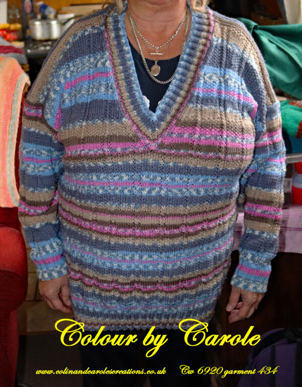 "A V neck jumper hand knitted aboard the narrow boat ""Emma Maye"" in Lancashire by Carole Wareing of Colin and Carole's Creations. Created from a shade of ""Fairground"" from J C Brett's (shade no G11) which is an acrylic yarn. Colours are shades of pink, blues and fawn's. A randomly striped jumper, unique, garment."