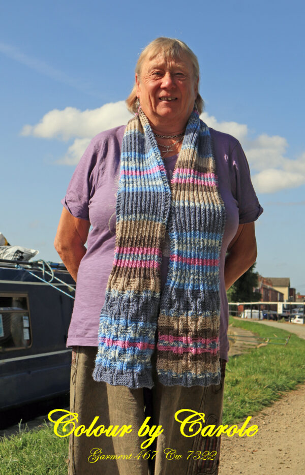An adult sized scarf hand knitted by Carole Wareing from Colin and Carole's Creations. The scarf has a basket weave pattern knitted into the final 9 inches, at either end.