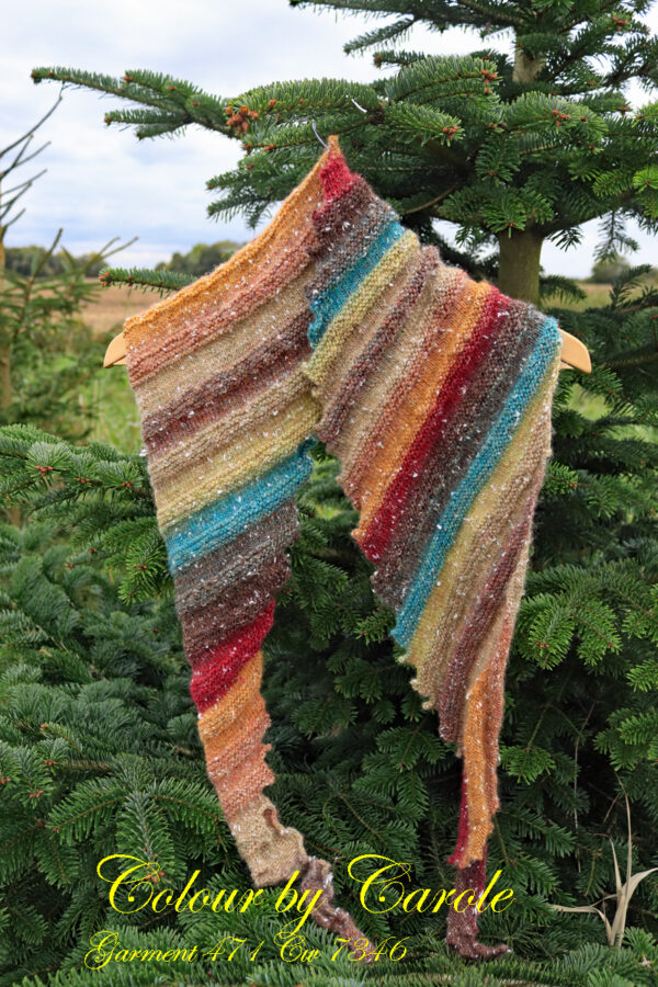 """Dragon tooth Autumn shades Northern lights shawl A Dragon tooth scarf hand knitted aboard the narrow boat """"Emma Maye"""" in Lancashire by Carole Wareing of Colin and Carole's Creations. This unique garment is an adult sized shawl, knitted from a yarn available from The Wool Boat which is produced by James C Brett."""