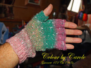 A pair of fingerless gloves designed and hand knitted by Carole Wareing of Colin and Carole's Creations and The Wool Boat.