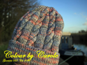 Carole has hand knitted this cabled hat from J C Bretts Stonewash acrylic yarn.