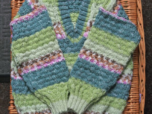 Childs Harmony V necked green jumper