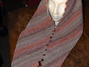 "A Dragon tooth shawl in shades of Orange, brown and grey shades hand knitted aboard the narrow boat ""Emma Maye"" in Lancashire by Carole Wareing of Colin and Carole's Creations. This unique garment is an adult sized shawl knitted from Marble yarn. This lovely warm garment will make a great handmade hug for someone you can't actually hug at the moment, or Christmas or Birthday present."