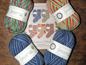Christmas sock yarn pack with free pattern book. A limited offer of 4 balls of West Yorkshire Spinners signature 4 ply sock yarn in Christmas shades.