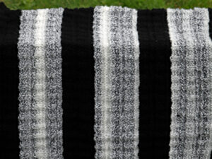 "A lovely hard wearing hand knitted blanket in Black, grey and white shades. Black, grey and white blanket, many uses, babies or pets spring to mind. The blanket is easy care, being machine washable at 40C and measures 21 inches by 26 inches (54 by 66 cm) and has been created from James C Bretts ""Top Valve"" acrylic double knitting yarn. Free delivery to UK addresses."