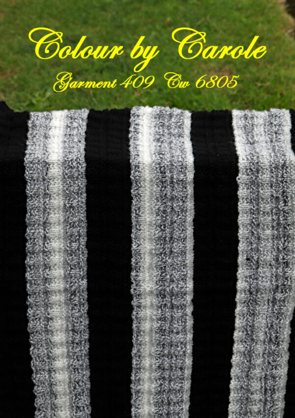 """A lovely hard wearing hand knitted blanket in Black, grey and white shades. Black, grey and white blanket, many uses, babies or pets spring to mind. The blanket is easy care, being machine washable at 40C and measures 21 inches by 26 inches (54 by 66 cm) and has been created from James C Bretts """"Top Valve"""" acrylic double knitting yarn. Free delivery to UK addresses."""