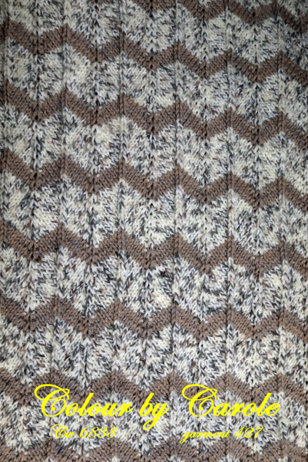 A lovely hard wearing hand knitted blanket in brown and a cream with flecks a wave's blanket Brown and a cream with flecks blanket, many uses, babies or pets spring to mind.