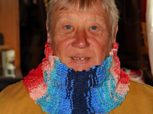 Blue and Red neck warmer A lovely warm neck warmer or headband designed and hand knitted and displayed by Carole Wareing of Colin and Carole's Creations and The Wool Boat. This is an adult sized garment, with chunky basket weave stitching, ideal for gardening, typing, mechanicing, IT work, locking, bicycling, standing markets, fishing, watching outdoor sports and events, or walking and rambling. The garment is approx 20inch round and 6 inch deep.